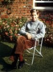 Colour photograph of Adam Hart-Davis sitting in the garden of the family home in Nettlebed, 1962.