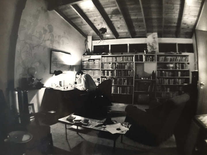 Black and white photo of Douglas Botting at his desk in the 1950s.