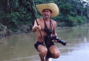 Photo of Douglas Botting on a canoe.