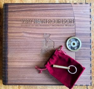 Colour photo of Super-De-Luxe Presentation Box with brass key resting on red velvet pouch.