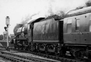 Black and white photograph of steam locomotive at Henley station, hauling the evening express from London, 13th June 1963.