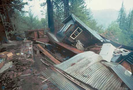 In a photograph taken by the US Geographical Survey a house destroyed by the Loma Prieta earthquake of 17th October 1989 keels over at a drunken angle.