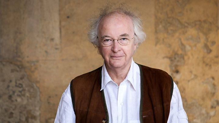 Photograph of Sir Philip Pullman wearing a nut-brown waistcoat.