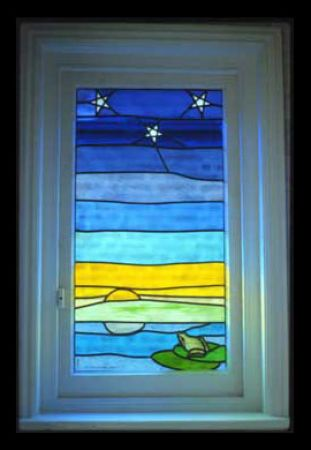 Stained-glass frog and stars.