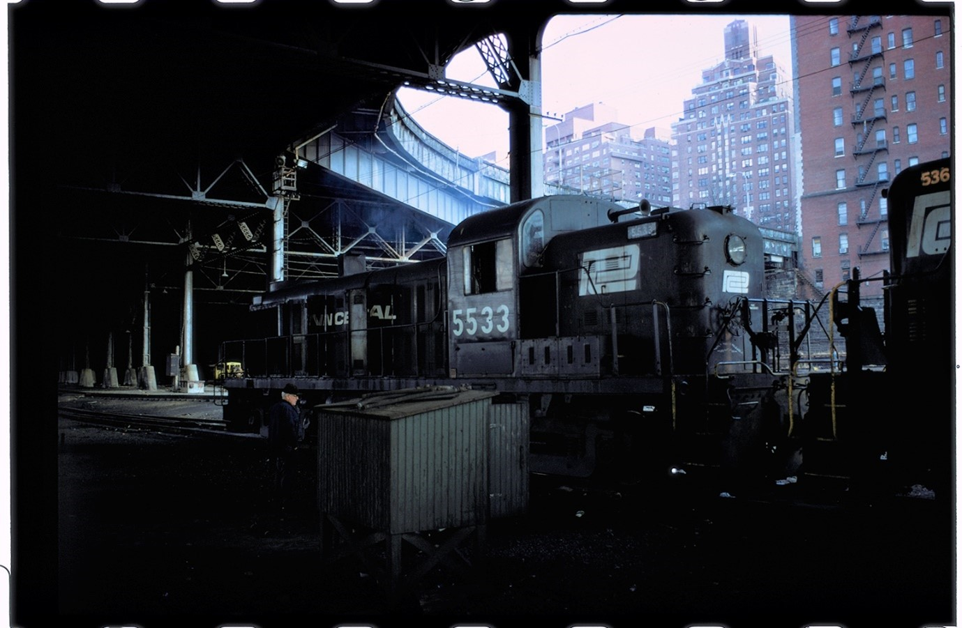 Colour photograph taken by Ian Logan in the 1970s of a Penn Central diesel locomotive in the West 60th Street yard in Manhattan.