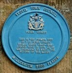 Colour photograph of a blue plaque marking the location of Thomas Hardy's home, a memorable part of Yeovil's literary scene.